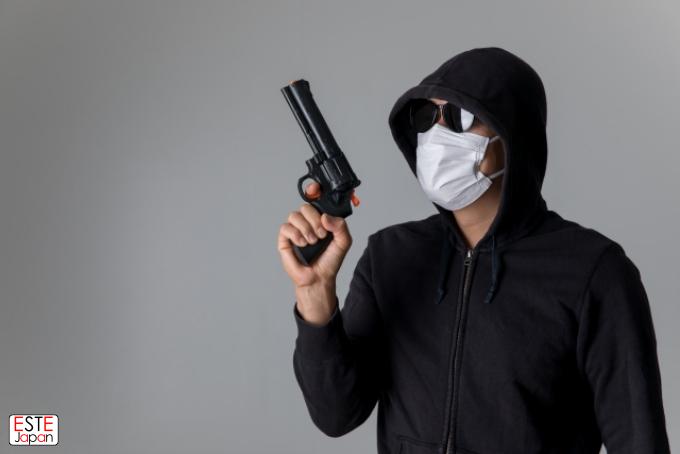 銃を持った犯罪者